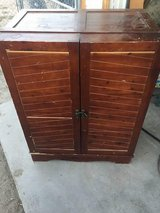 Solid cherry wood wine cabinet in 29 Palms, California