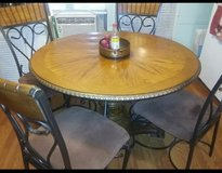 Solid wood dining room table and 4 chairs in Pensacola, Florida