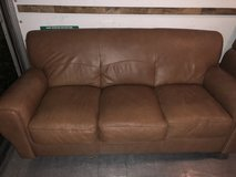Brown leather couch in Fort Rucker, Alabama