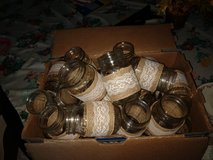 35 pint size Mason jars wrapped in burlap and lace.  Wedding in Warner Robins, Georgia