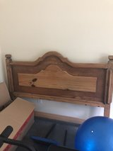 Rustic pine headboard in Baytown, Texas