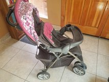 Purple Graco collapsible stroller, car seat, and base in Phoenix, Arizona