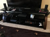 Glass and wood tv stand in Fort Leonard Wood, Missouri