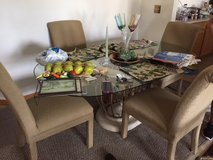 Glass top table with 4 chairs - well built in Chicago, Illinois