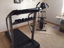 Stationary bicycle and Treadmill with weights in Oswego, Illinois