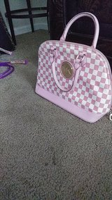 Pink and white purse in Columbus, Georgia