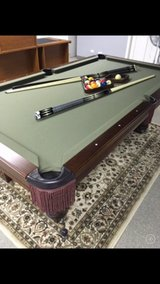 Pool table w beautifully carved craftsman legs in Bolingbrook, Illinois