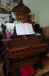 Antique pump organ and bench in Waldorf, Maryland