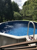 12 ft round above ground pool with pump and sand filter in Chicago, Illinois