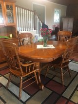 Oak dining table with leaf and 6 chairs & matching hutch in Pleasant View, Tennessee