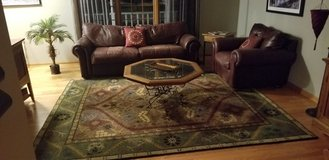 leather couch with matching large chair coffee table and 8x10 area rug in Wheaton, Illinois