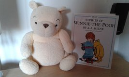 Jointed Winnie the Pooh teddy and story book in Lakenheath, UK