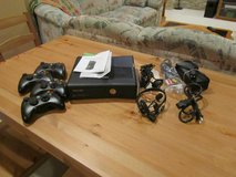 Xbox 360 Slim w/4 controllers & extra internal hard drive (100 GB) in Batavia, Illinois
