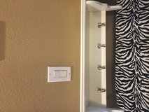 White shelf with hooks in Vacaville, California