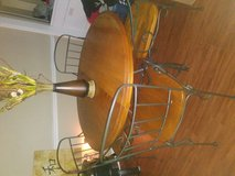 Dining table wooden heavy duty with iron comes with converter from small round to long oval for ... in Bellaire, Texas