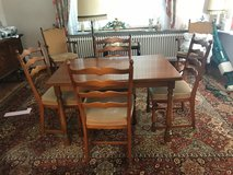 solid wood dining room set with 2 tug in extension leaves and 6 chairs in Spangdahlem, Germany