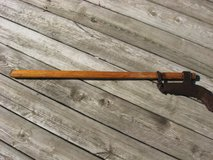 Antique Homesteader Brushing Axe in Chicago, Illinois