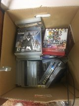 a box full of ps3 games in Okinawa, Japan