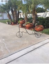 bike with 3 clay flower pots in Vacaville, California