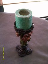large decorative candle holder and candle in Warner Robins, Georgia