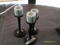 3 bronze candle sticks with candles in Warner Robins, Georgia