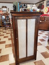 Antique tiger oak cabinet in Fort Leonard Wood, Missouri