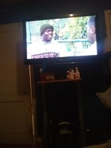 Like new LG 42' flat screen w/ stable built stand in Fort Polk, Louisiana