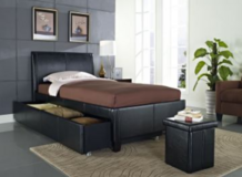 Black trundle bed with 2 twin mattresses. in Hill AFB, UT