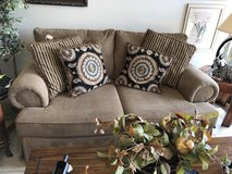 Tan sofa with pillows in Chicago, Illinois