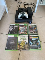 XBOX 360 + x1 cordless remote + 1 cordless + games in Ramstein, Germany