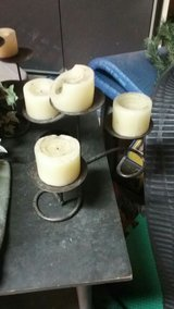 candles on metal candle holders used in fire placd in Lawton, Oklahoma