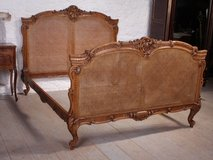 French Elaborately carved good quality caned European king size bed in Birmingham, Alabama