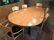 Contemporary Egg Shaped dining table, 8 chairs and sideboard in Joliet, Illinois
