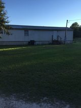Two bedroom one bath mobile home with carport storage building in Cottonwood community in Leesville, Louisiana