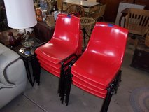 Set of Eight Stackable Red Chairs in Fort Riley, Kansas
