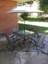 Small patio table with 4 chairs and umbrella in Oswego, Illinois