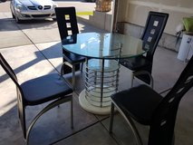 Modern  round Glass dining table with 4 chairs in Fort Carson, Colorado