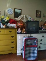 Large Suitcase- On wheels.. Has handles on side and top AND a pull handle in Hopkinsville, Kentucky