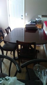 Dining room table with extra leaves in Naperville, Illinois