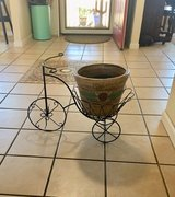 Bike with clay flower pot in Vacaville, California