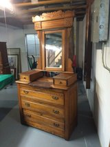 Antique twin oak headboard and dresser in Chicago, Illinois