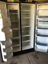 Refrigerator - Whirlpool gold side-by-side stainless in Plainfield, Illinois