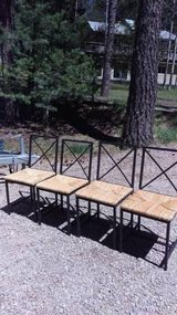 Metal and Rush dining room chairs in Ruidoso, New Mexico