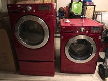 LG red front load washer dryer set with pedestals in Lockport, Illinois