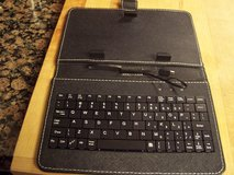 Tablet holder with keyboard in Conroe, Texas