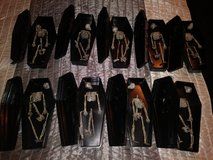 Treat coffins with skeletons in Spring, Texas