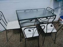Glass and Iron table and chairs in Saint Petersburg, Florida