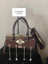 BRAND NEW!Burgundy/Black shiny patent leather with gold chain/pearl accents and gold fastener CO... in Nellis AFB, Nevada