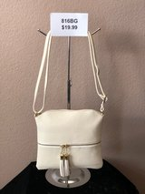 BRAND NEW! Beige crossbody w/gold and white tassel accent/functioning front pocket/adjustable st... in Nellis AFB, Nevada