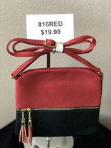 BRAND NEW! Red crossbody w/gold and red tassel accent/functioning front pocket/adjustable strap ... in Nellis AFB, Nevada